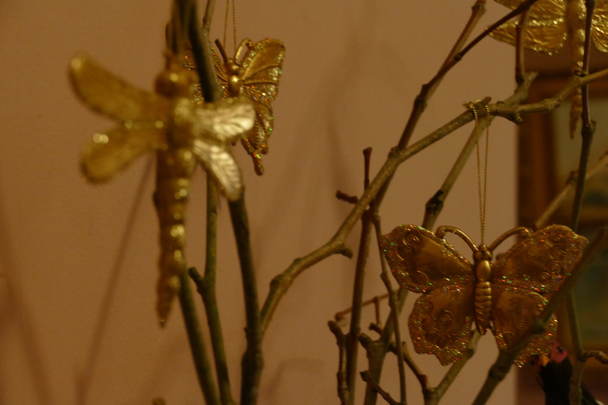 Photo of gold butterflies ornaments on sticks